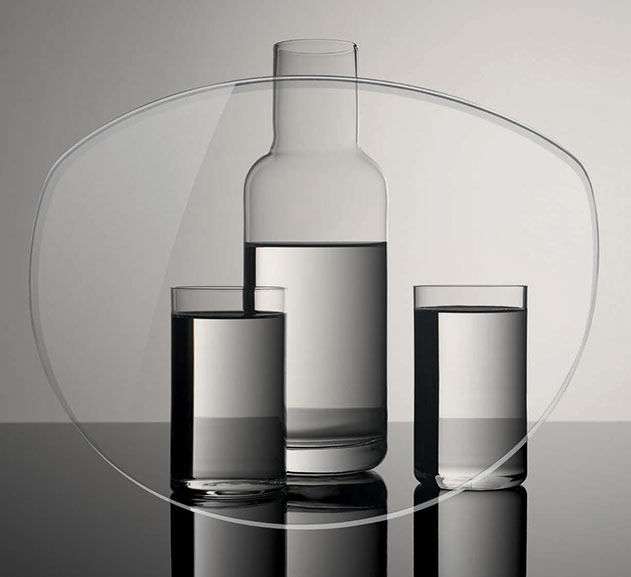 3 glasses filled with water, which do not appear distorted through the glasses lens