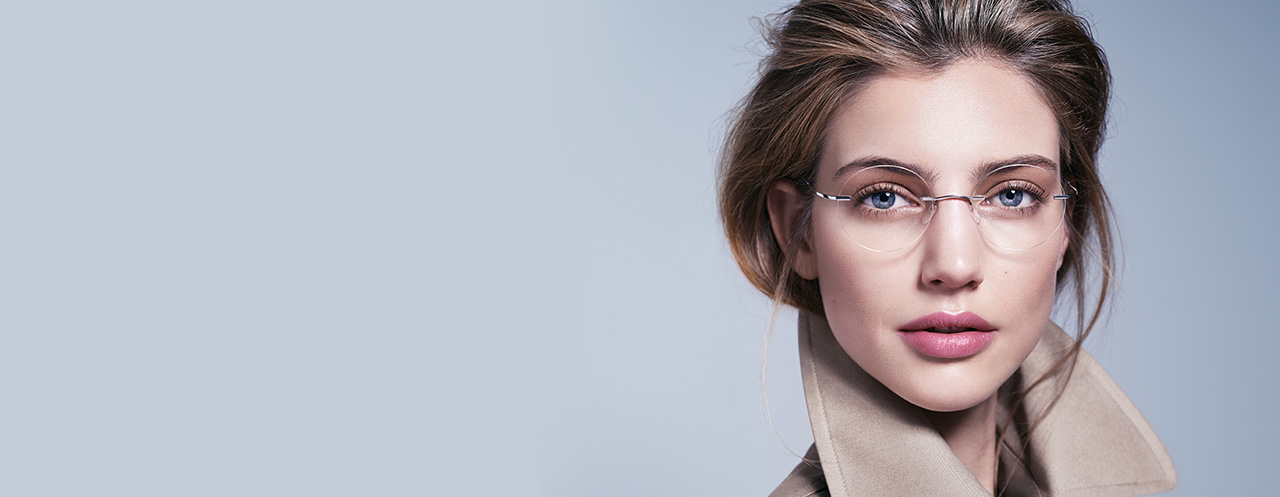 Female model wears rimless Silhouette glasses with Vision Sensation lenses