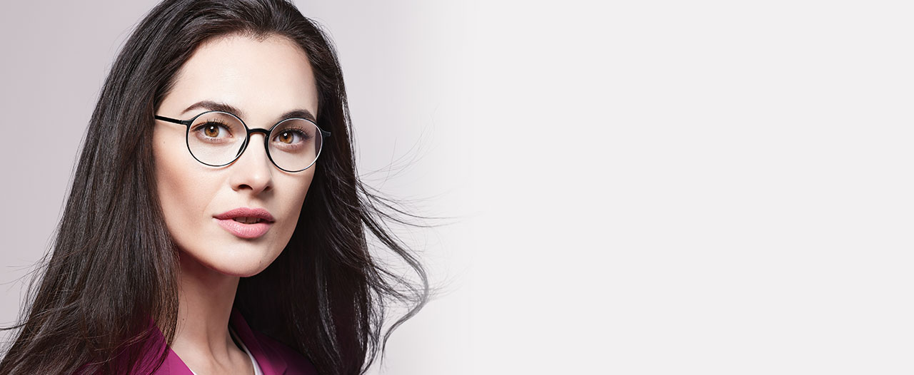 Female model wears Urban LITE full rim glasses by Silhouette with Vision Sensation™ lenses