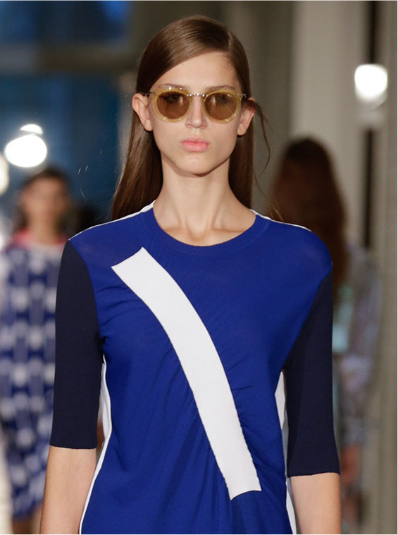 Model wearing a blue dress on the catwalk with Arthur Arbesser for Silhouette eyewear