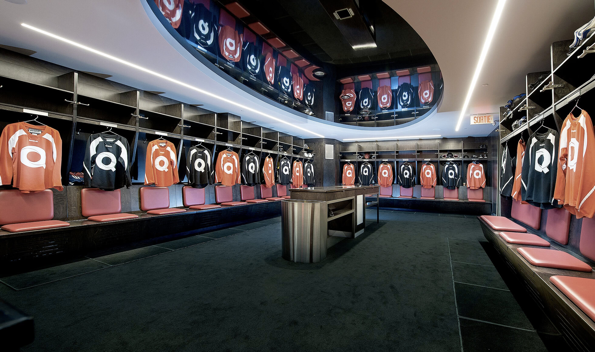 Luxury hockey dressing room at Hockey Etcetera with individual player stalls, each with their own Quartexx practice jersey.
