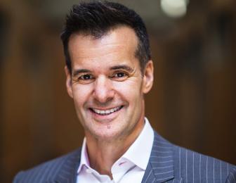 A headshot of Lino Saputo Jr. smiling