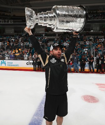 Andy O'Brien lifting the Stanley cup