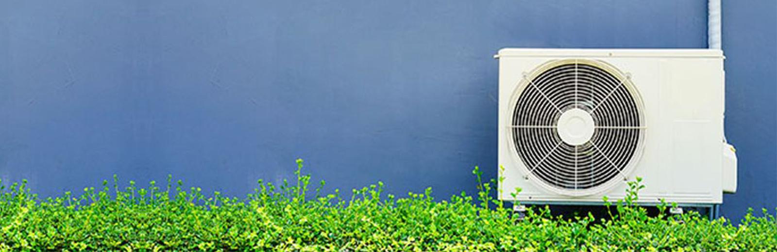 air source heat pump outside green