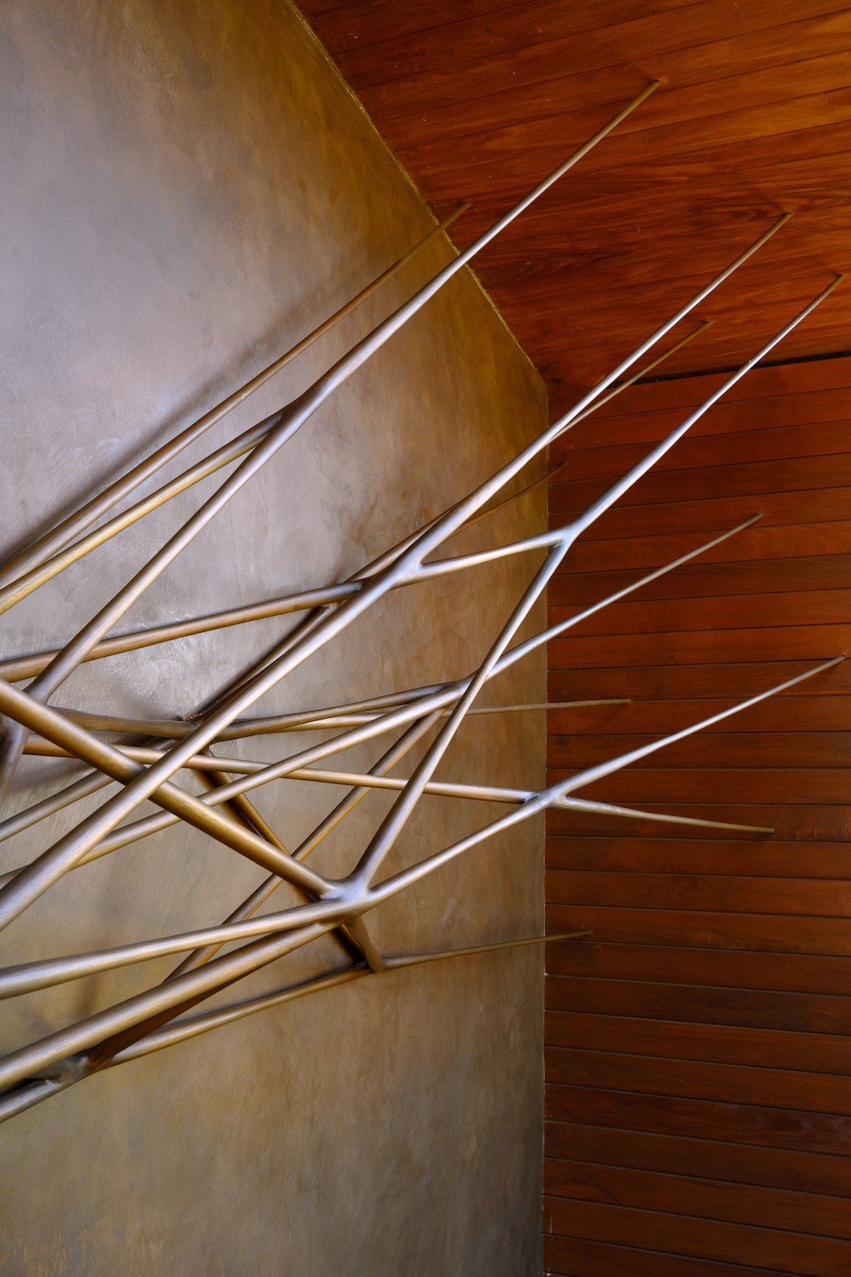 surface detail of Portal, a sculpture by Christopher Kurtz, installed on a home