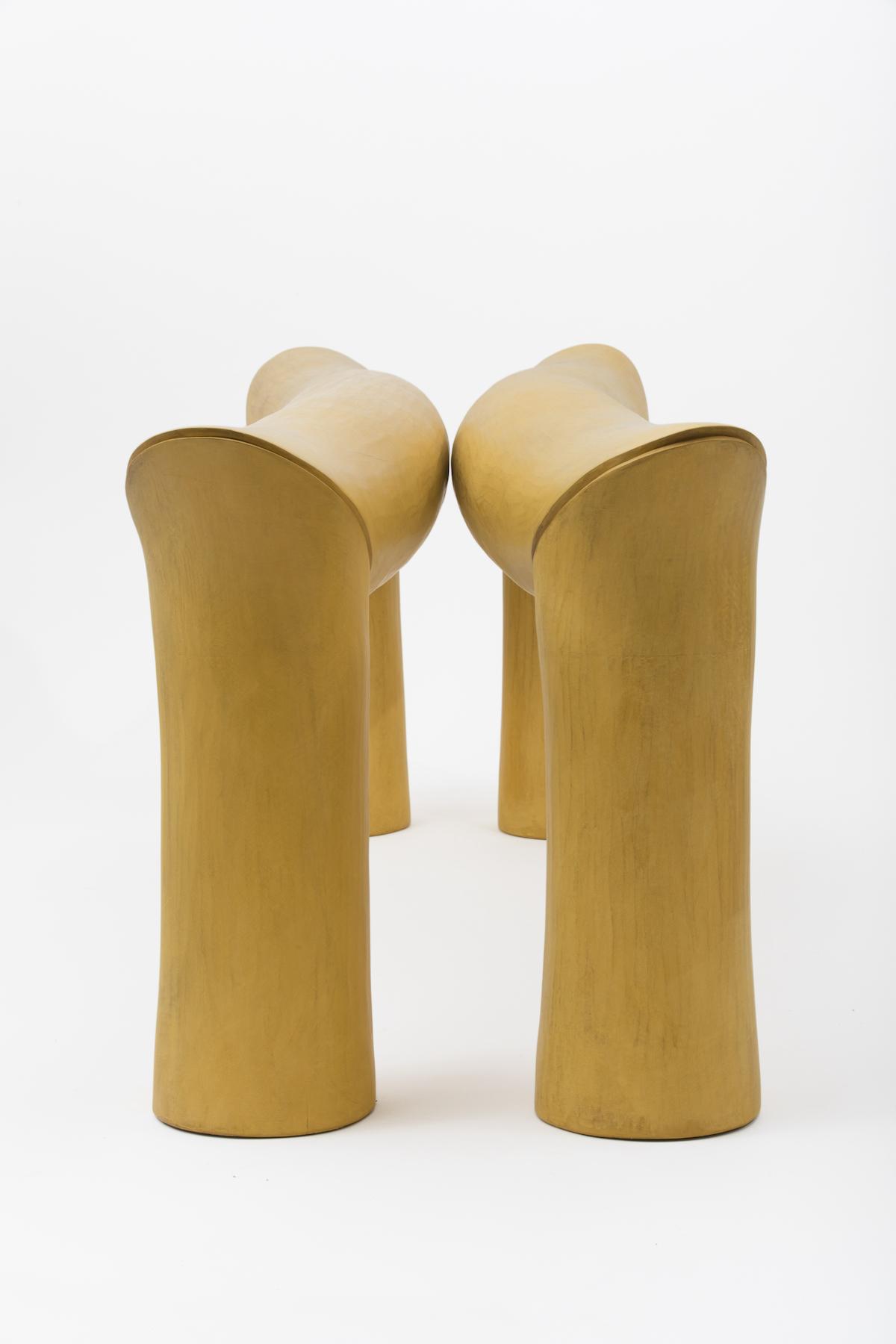 side view of Duck Bill Miter, a yellow sculptural piece by artist Christopher Kurtz