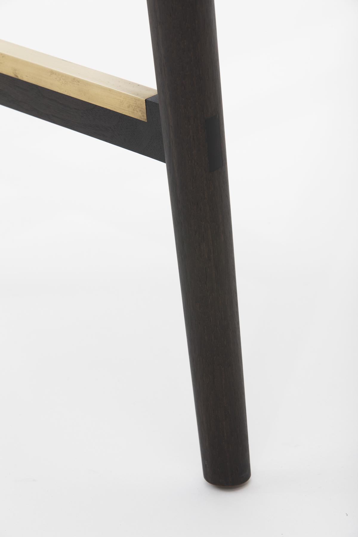 Stretcher/leg detail of the Redwood Bar/Counter Stool by artist Christopher Kurtz