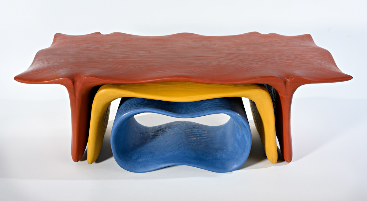 brightly colored nesting tables by artist Christopher Kurtz