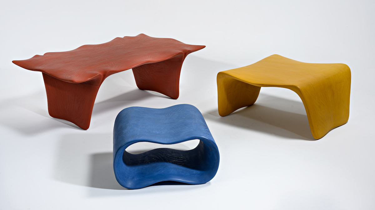 separated view of brightly colored nesting tables by artist Christopher Kurtz