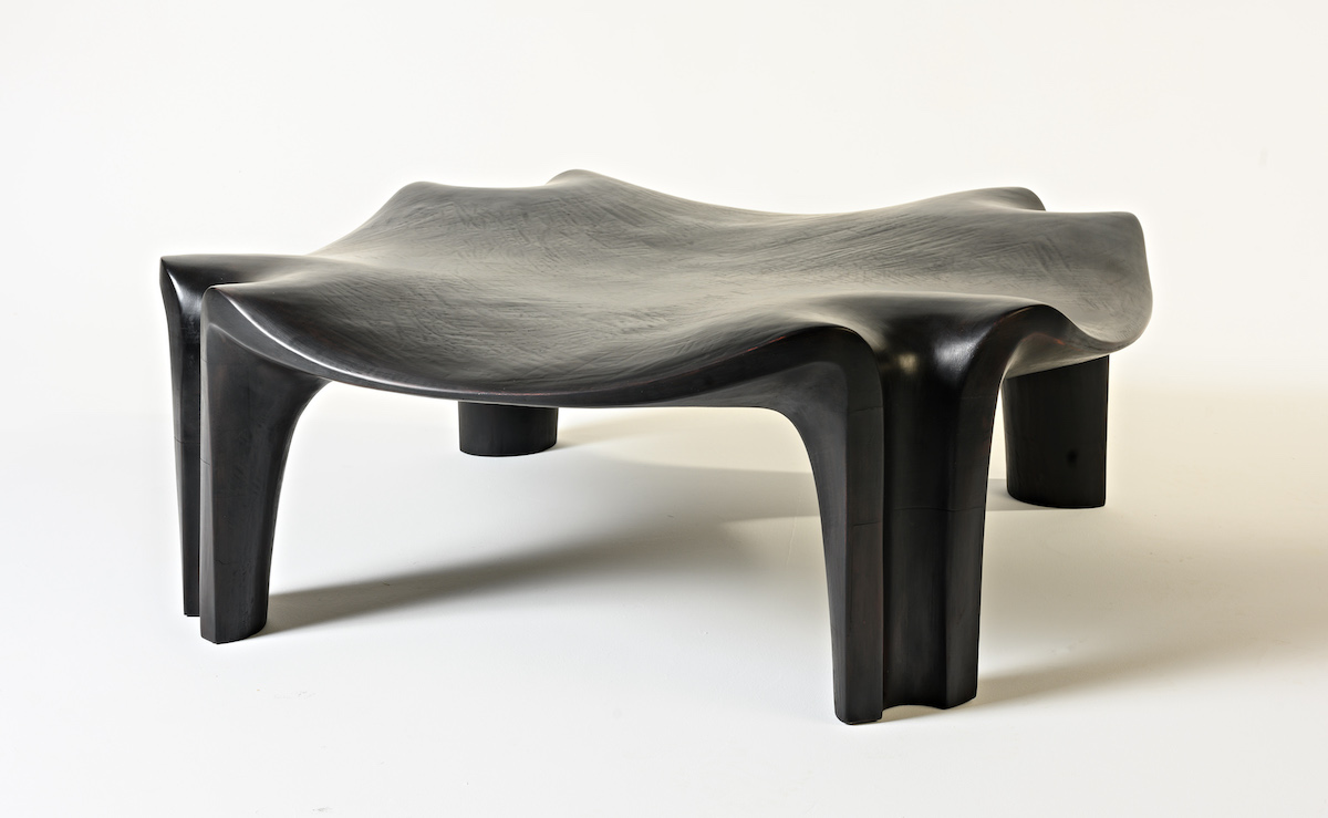 side view of the Thebes Bench by artist Christopher Kurtz