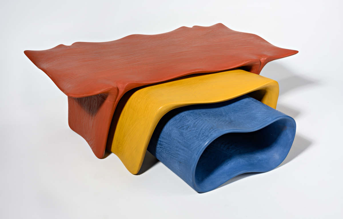 bright red, blue and yellow nesting tables by artist Christopher Kurtz
