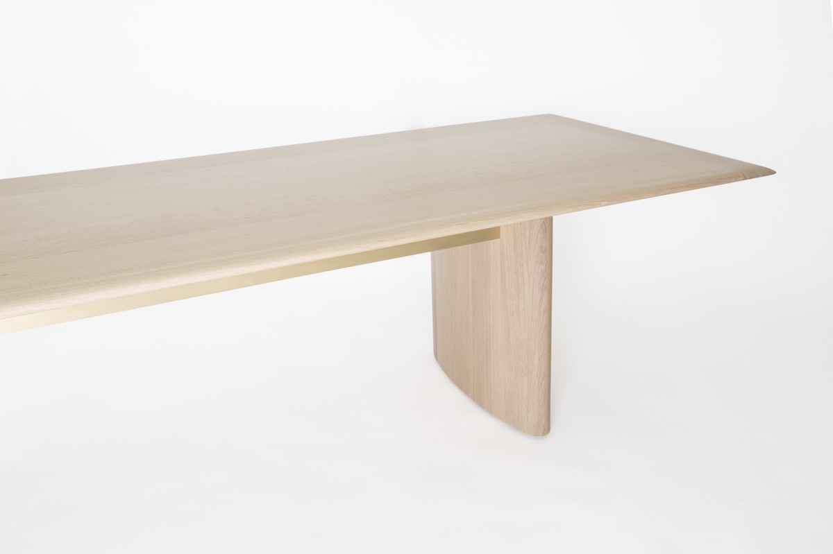 angled view of an oak dining table by artist Christopher Kurtz