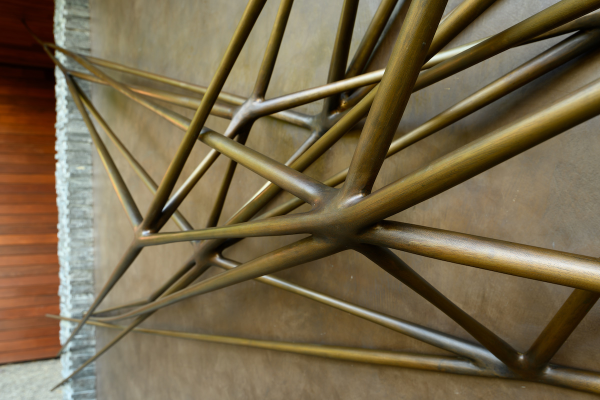 angled detail of Portal, a sculpture by Christopher Kurtz, installed on a home