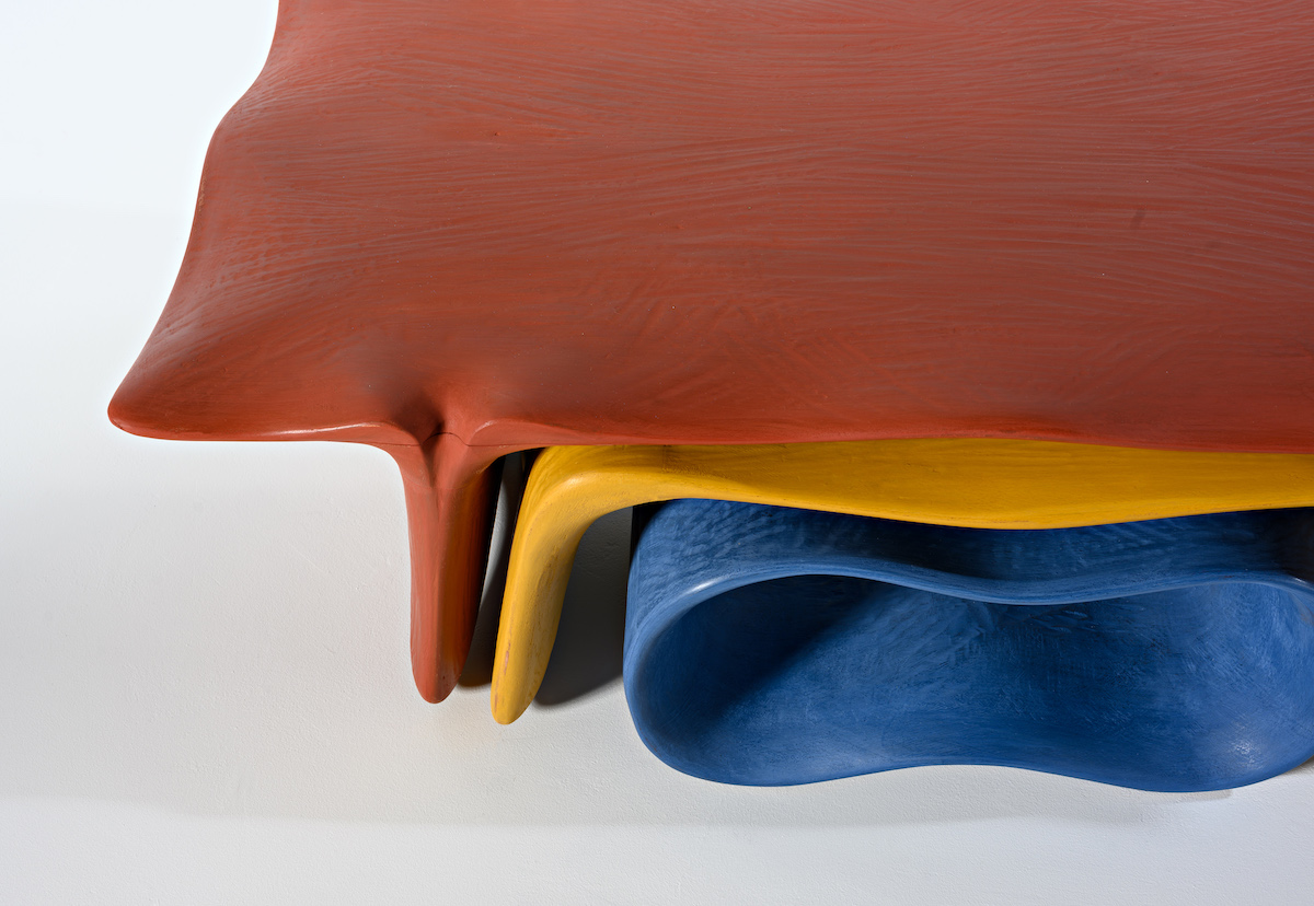 surface detail of brightly colored nesting tables by artist Christopher Kurtz