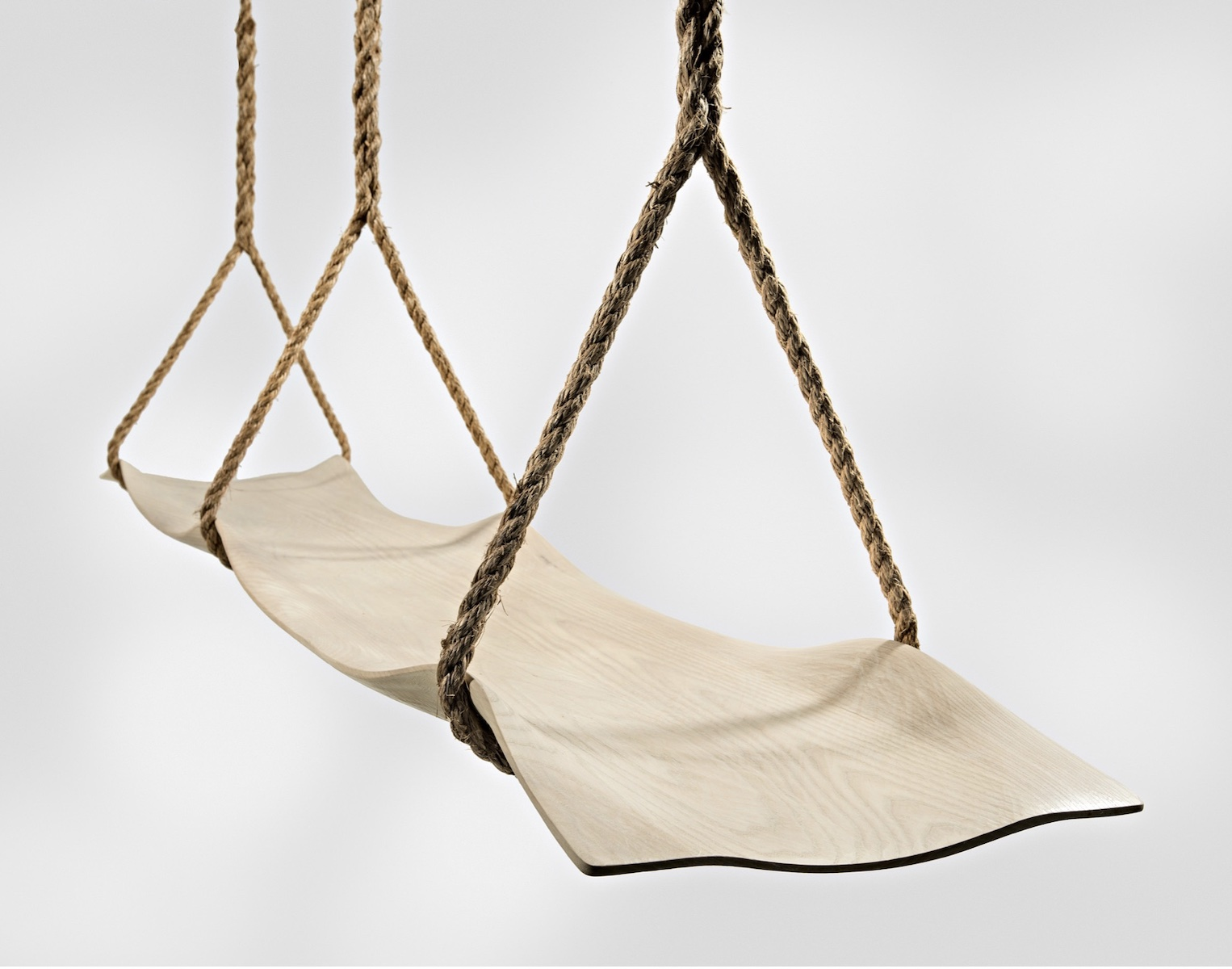 angled view of the double Swing Seat by artist Christopher Kurtz