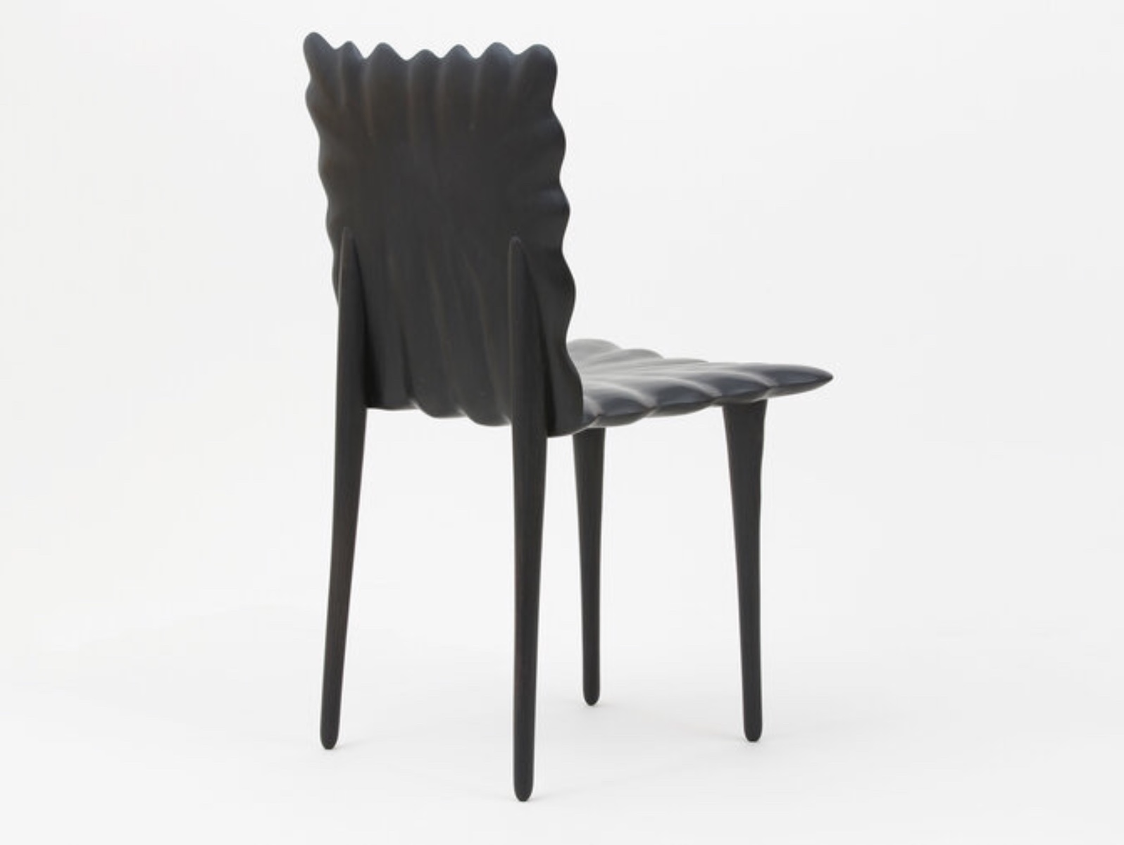 back view of the Saddle Chair by artist Christopher Kurtz