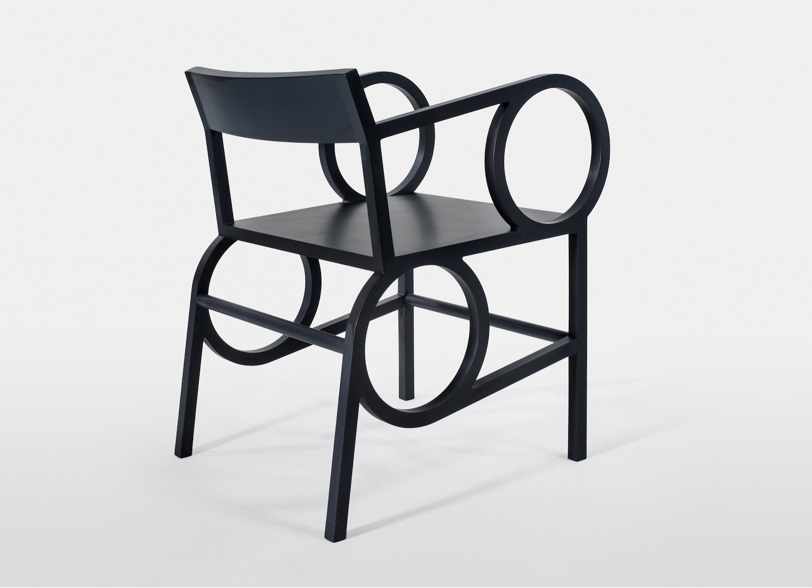 angled view of the Circle Arm Easy Chair by artist Christopher Kurtz