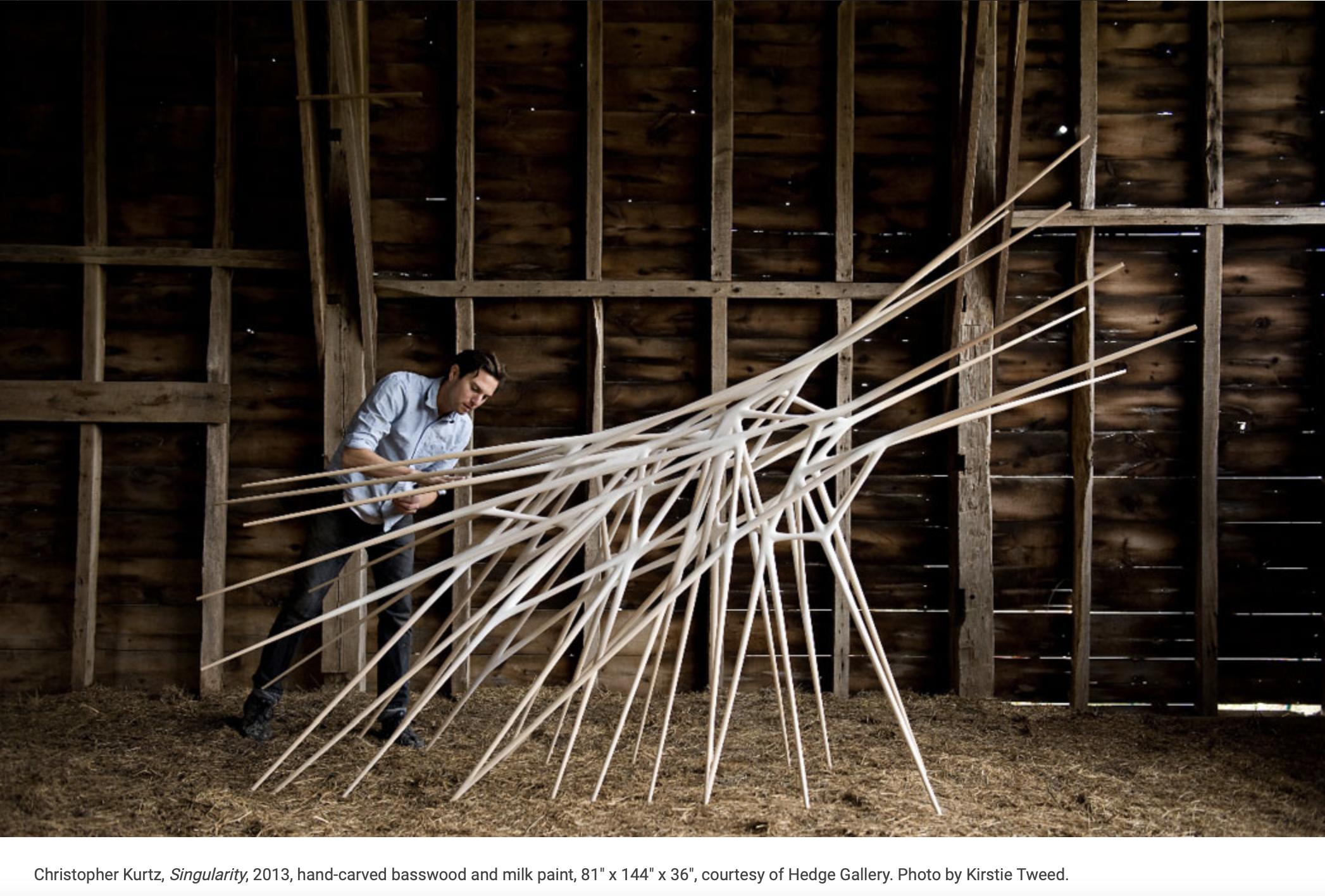 Christopher Kurtz with his sculpture Singularity featured by KC Studio magazine