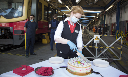 Deutsche Bahn employees celebrating the success of the Starke Schiene campaign and employees dedication next to the tracks with plenty of cake for everyone.