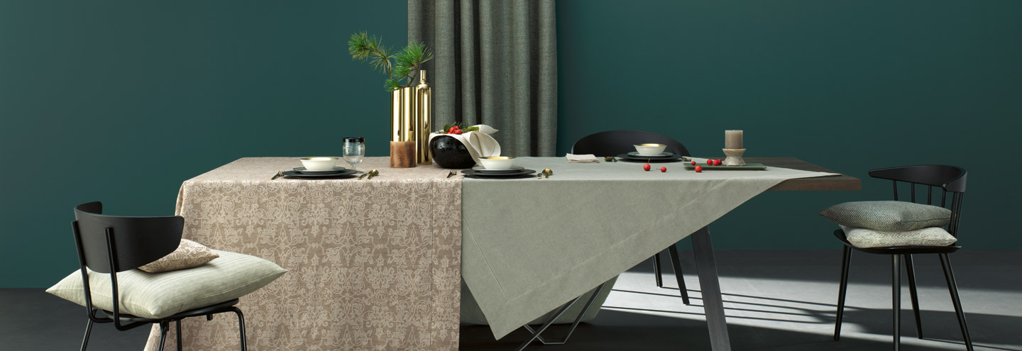 Modern, festive table decorated with tablelinen by Leitner Leinen.