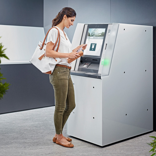 Woman uses an ATM of the evo series