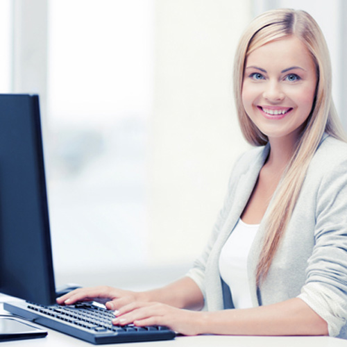 Woman working at a computer.