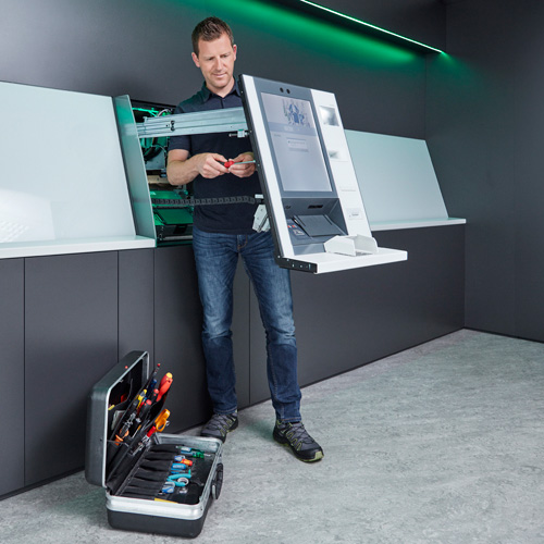 A service technician works on a ATM of the evo eries.