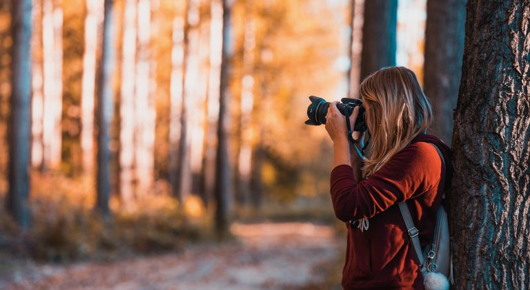 girl taking a photo in the nature