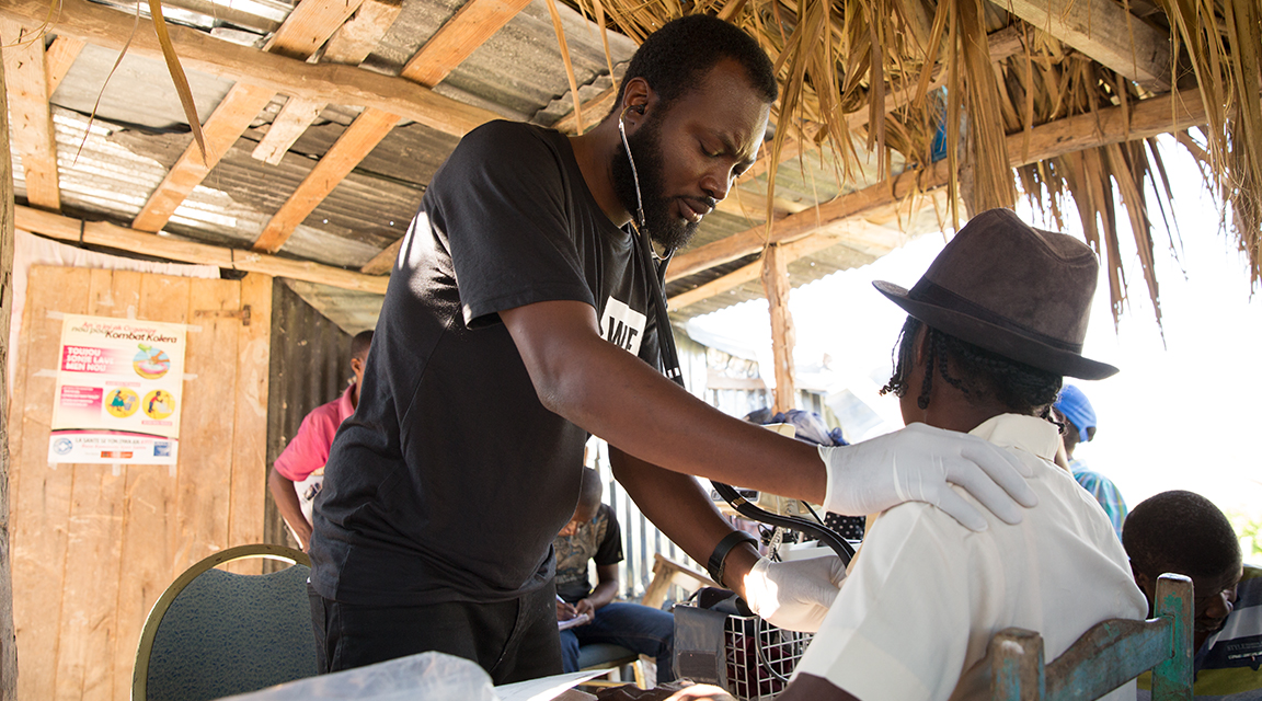 A doctor in Haiti performing a check up