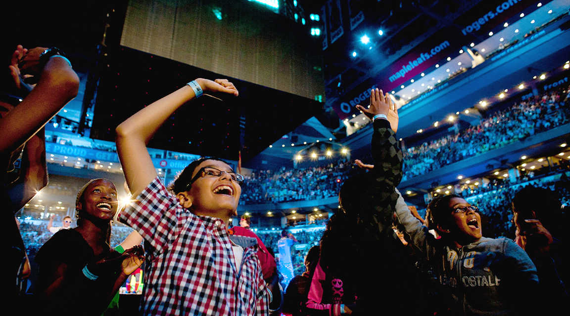 Attendants of WE Day cheering