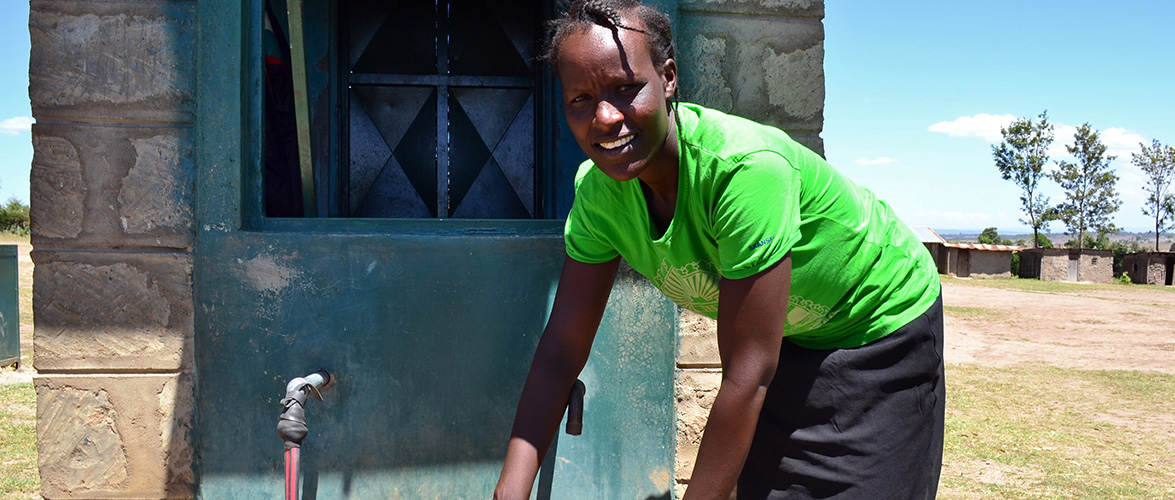 Mercy Rop collecting water from a tap in Kenya