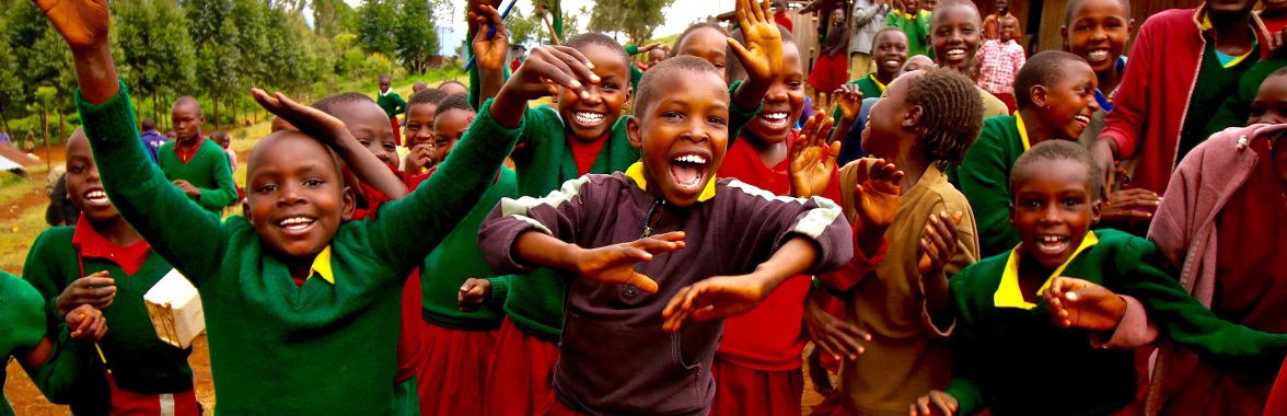 Young local students celebrating in Kenya