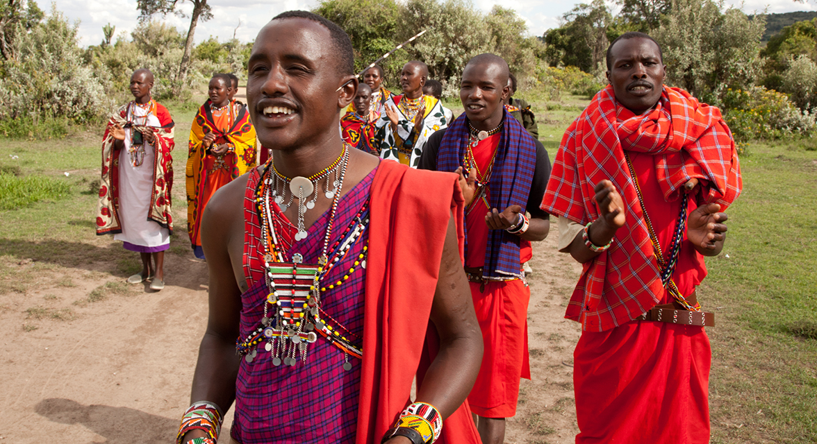 Locals in traditional clothing walking down path in Kenya