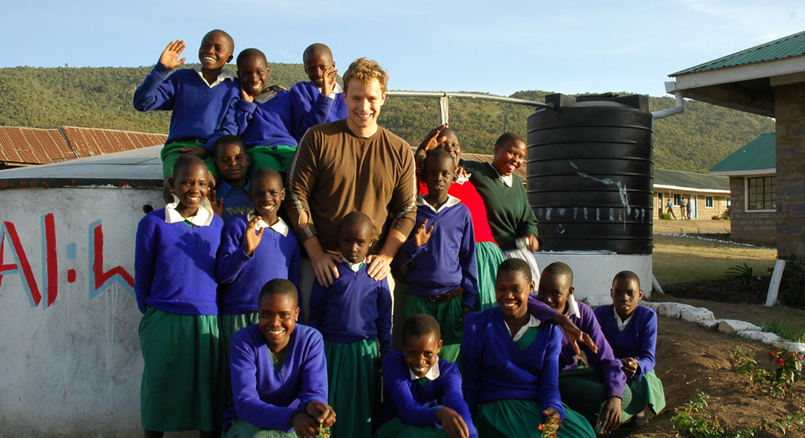 Marc Kielburgers with students in Kenya around a new water well