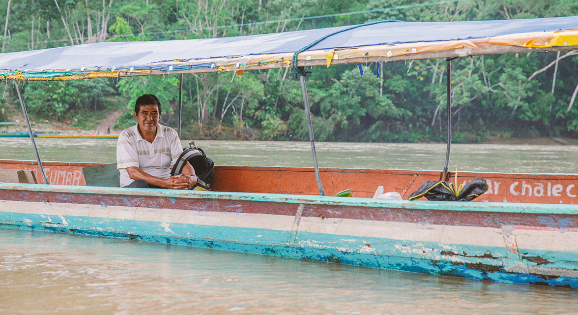 A man steers a boat on the Napo River