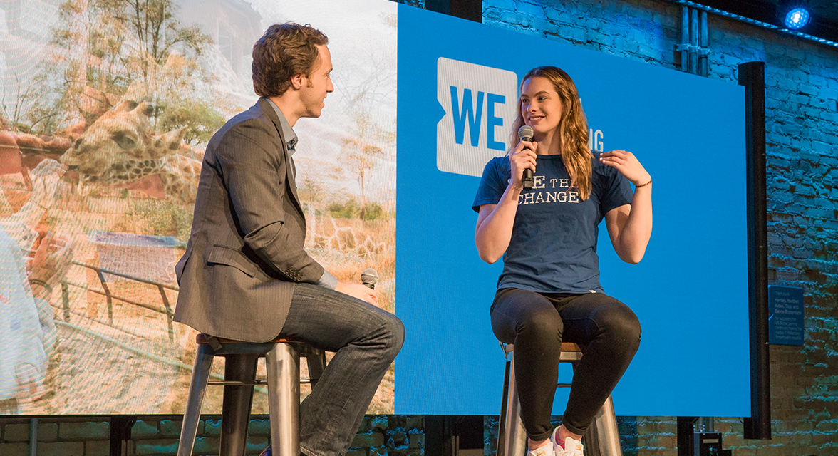 Craig Kielburger and Penny Oleksiak speaking at a WE event