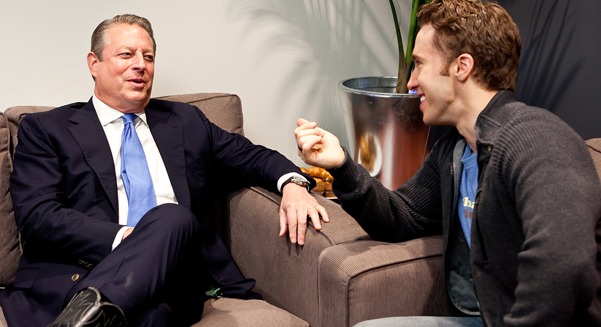 Craig Kielburger speaking to Al Gore backstage at WE Day