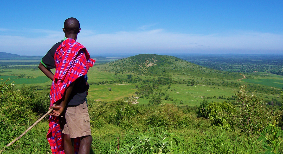 Local community member overlooking landscape in Kenya