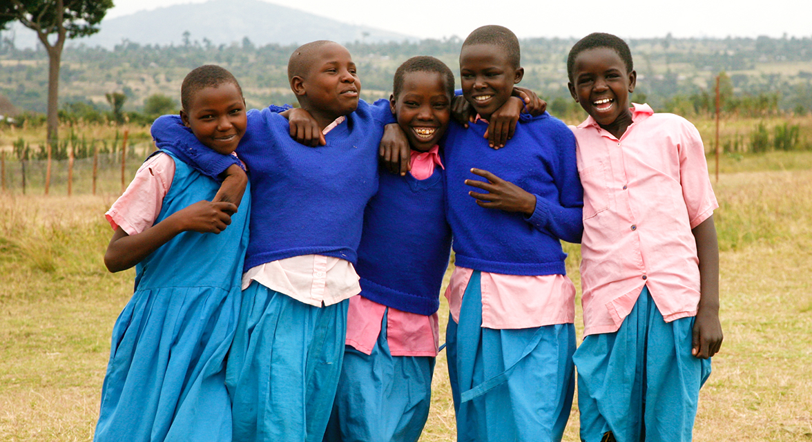 Local Kenyan students laughing together outside