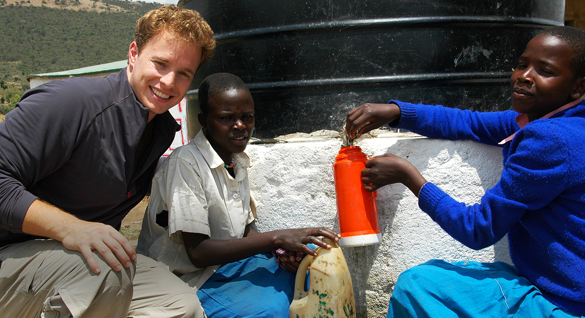 Marc Kielburger with local students at a water project in Kenya