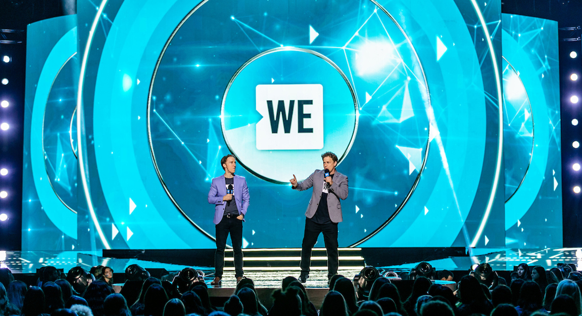 Craig and Marc Kielburger speaking at WE Day event