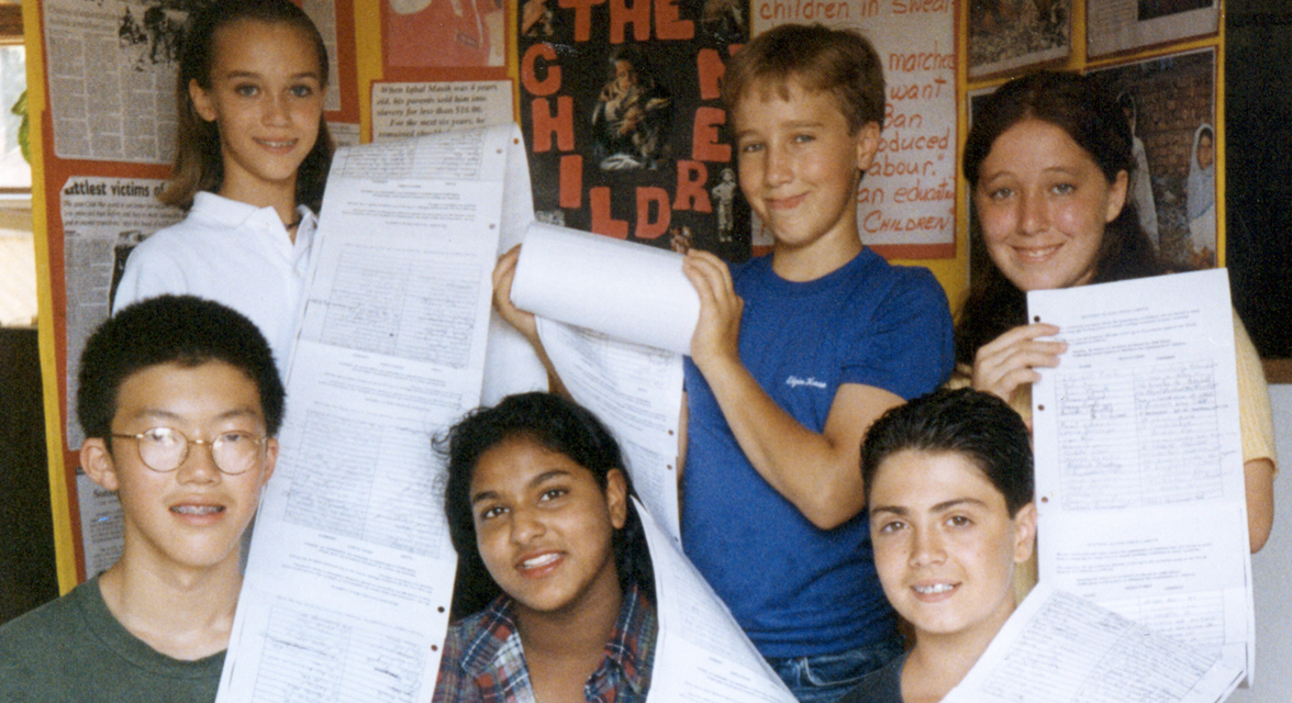 Craig Kielburger and the Twelve 12-year-olds with signed petition list