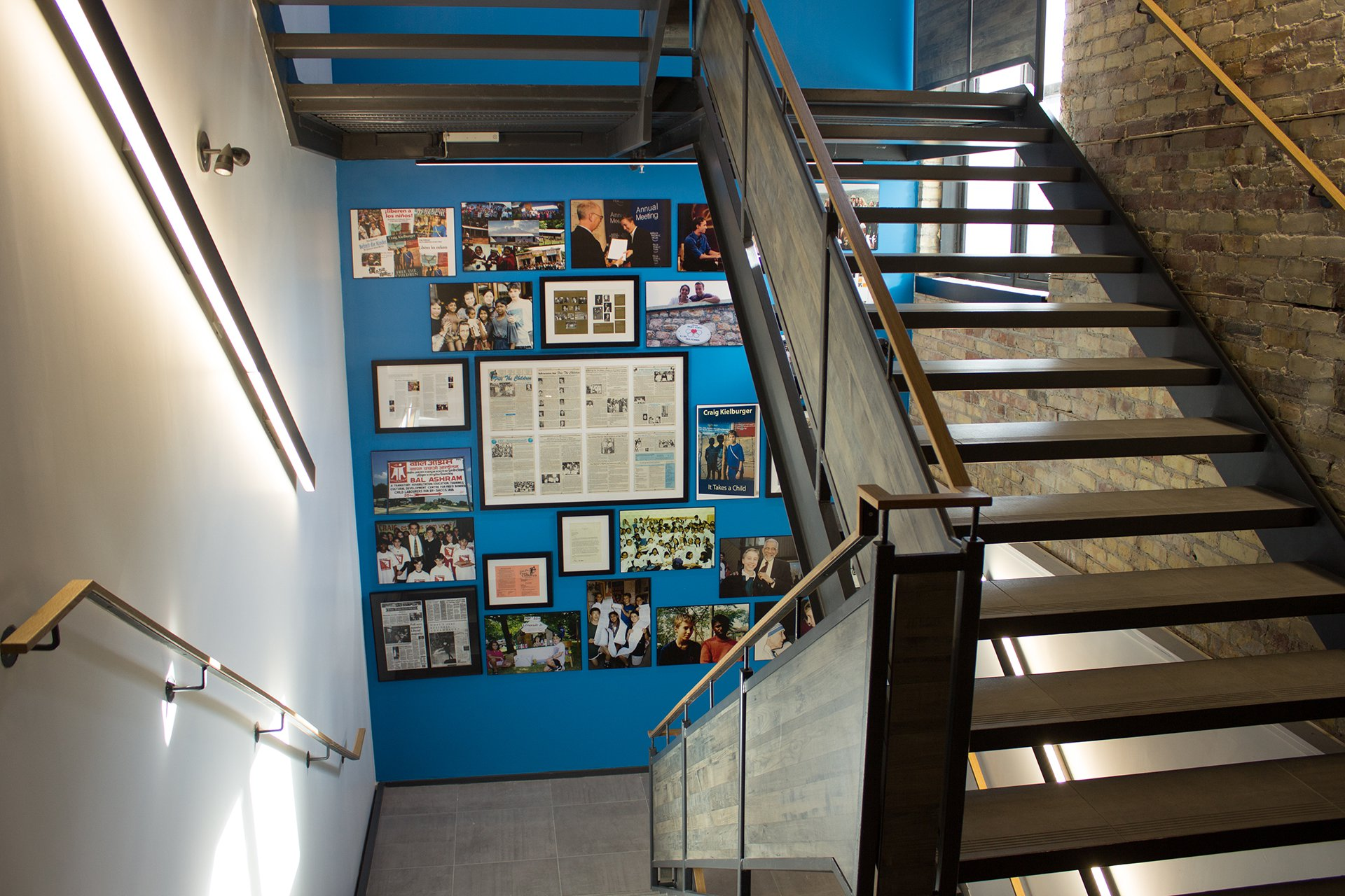 Important moments from the history of WE are displayed in a stairwell in the WE Global Learning Center.