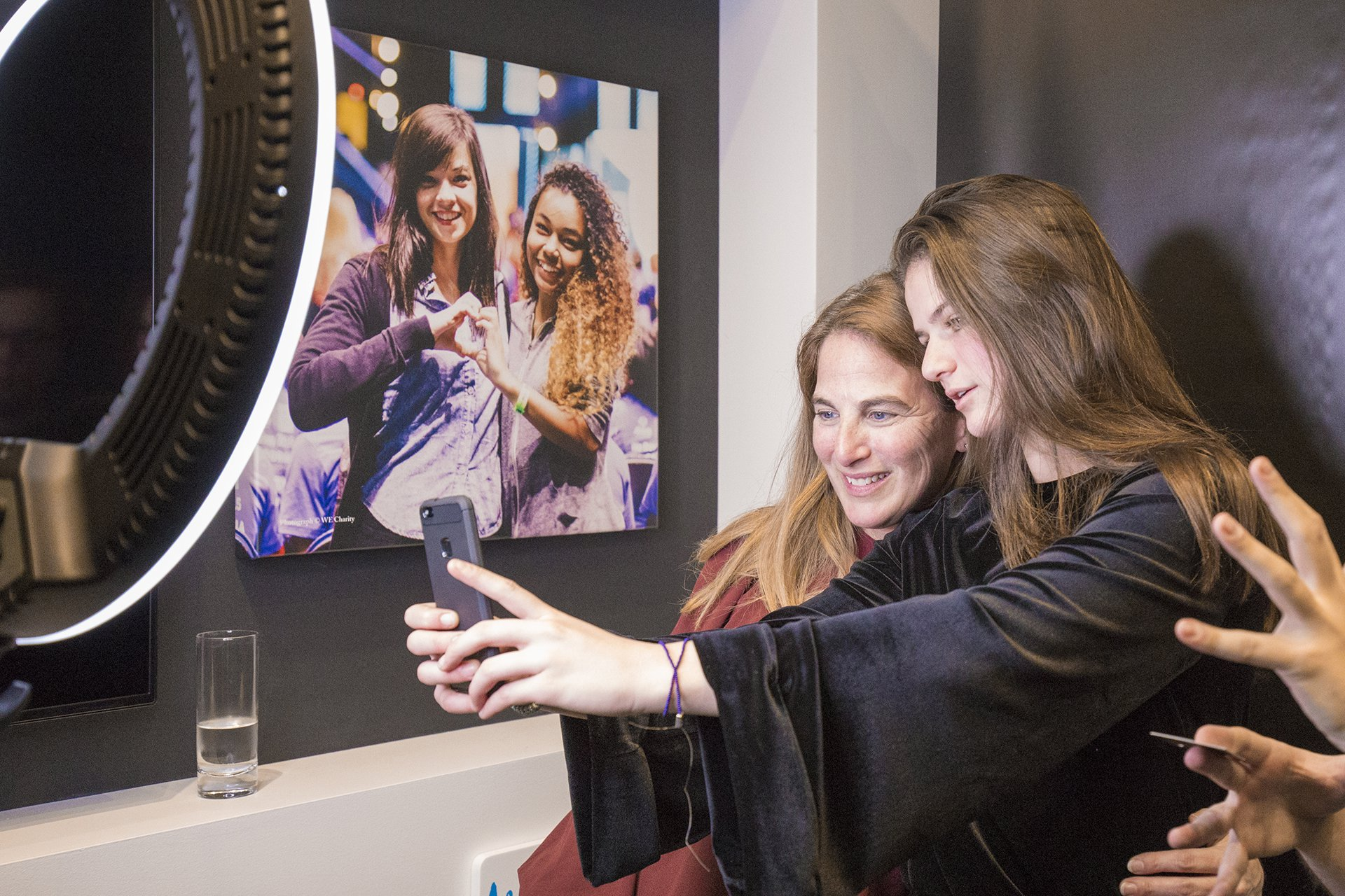 Two people take a selfie at the WE Global Learning Center.