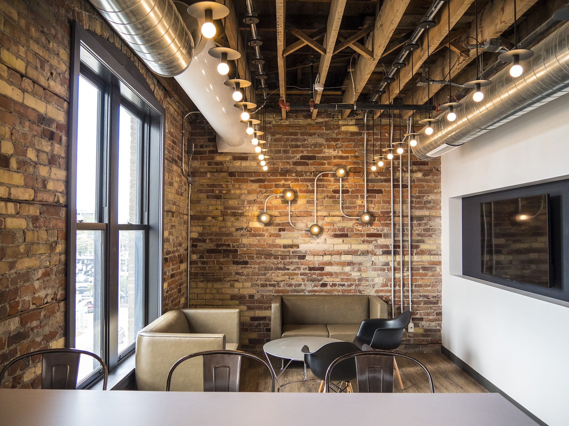 The kitchens in the WE Global Learning Center feature exposed brick and floor-to-ceiling windows.