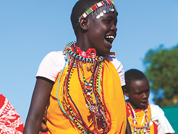 Locals celebrating in traditional clothing in Kenya