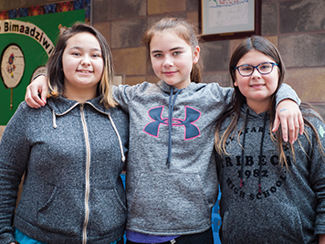 Three indigenous students at school