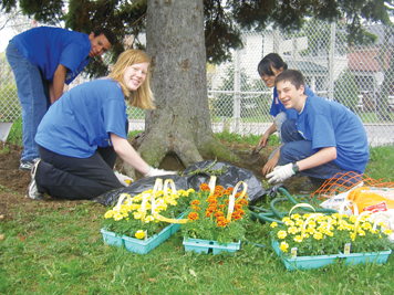 Students planting for WE Go Green campaign