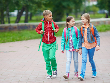 Young students walking to school together