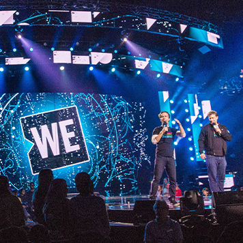 Craig and Marc Kielburger at a WE Day event